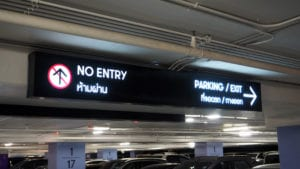 Digital parking signs with showed word no entry and exit and available space.